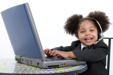 Beautiful Little Business Woman Working On Laptop.  photo