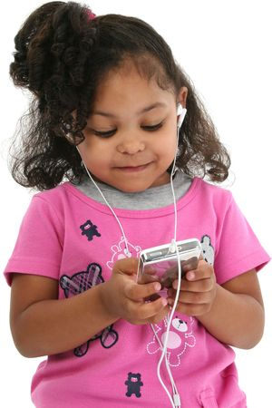 earphone: Three-year-old girl in pink listening to music. Shot with Canon 20D.