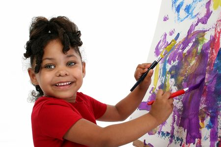 Three-year-old African-American girl painting. Shot with Canon 20D.