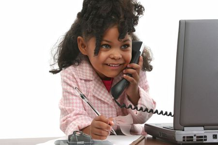 Little business woman using phone, laptop computer, and note pad. Standard-Bild