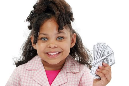 Little business woman with pink and white suit and money. Shot with Canon 20D. Stock Photo