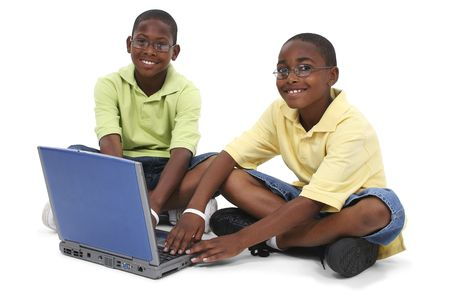 brothers: Brothers Working On Laptop Computer Sitting On Floor. Shot in studio over white with the Canon 20D. Stock Photo