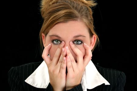 Beautiful young business woman with her hands over her face. Stock Photo - 3773010