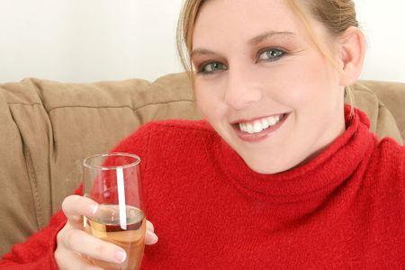 Beautiful young woman with glass of champange. photo