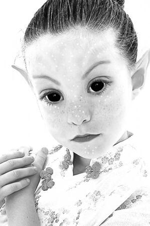elves: Illustration photograph of black and white alien girl over white. Stock Photo