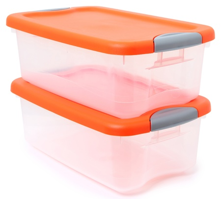 housewares: Orange and clear plastic storage container bins stacked over white background.
