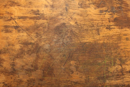 Close up shot of distressed wooden desk top texture. Stock Photo