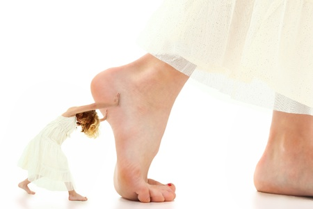 Concept image of young girl pushing herself or staying motivated over white background.