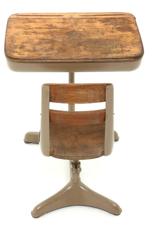 old desk: Back side of old single student school desk over white background. Stock Photo