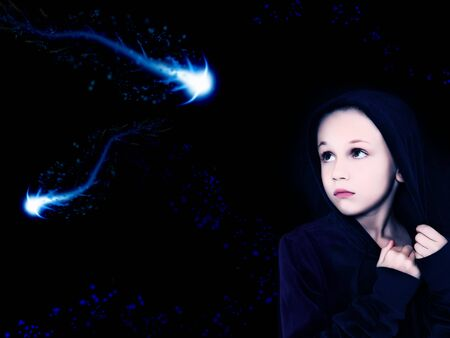 night: Beautiful girl looking at space creatures in the night sky.