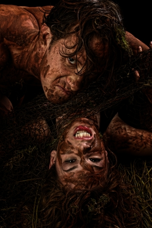 Fantasy character portrait of couple in mud over black. Imagens - 20963172