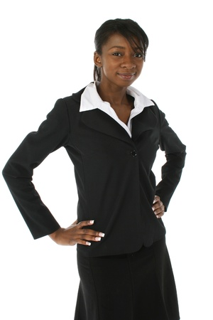 Beautiful young african american business woman in suit over white background. photo