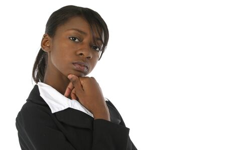 Attractive young business woman in suit looking serious at camera over white background.
