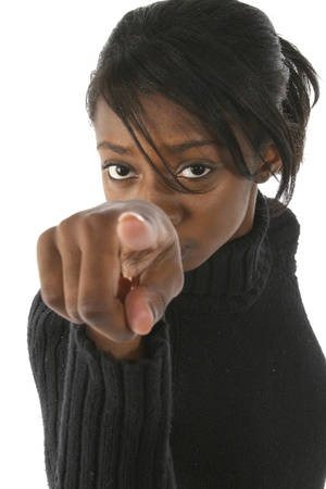 Attractive young african american woman pointing into camera over white background. photo