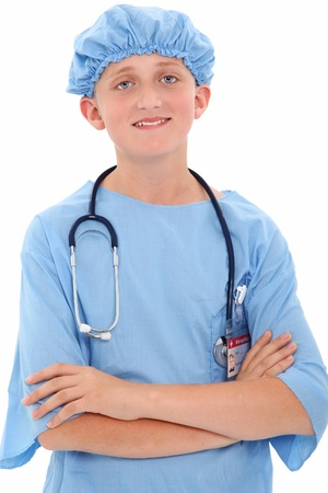 role play: Adorable 12 year old boy dressed in sugercal scrubs over white background. Stock Photo