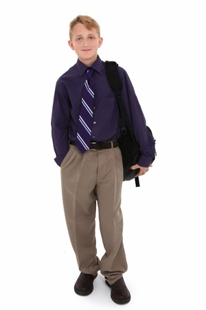 boy 12 year old: Attractive 12 year old boy in dress shirt and tie with backpack over white background.