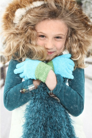 Freezing cold child in snow storm outside. Stock Photo - 8405354