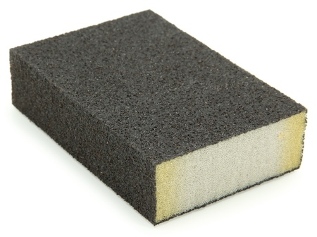 Isolated sanding block sponge over white background.