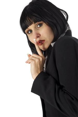 19 year old: Attractive 19 year old woman in suit making hush gesture Stock Photo