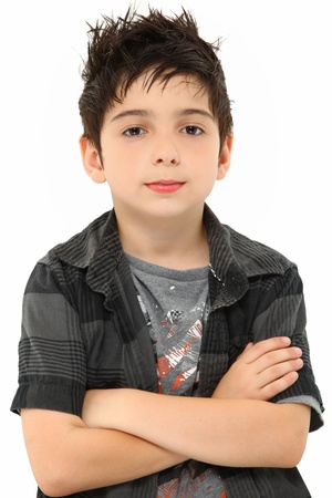 messy: Attractive eight year old portrait of boy with stylish hair over white arms crossed. Stock Photo