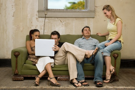 Group of college study buddies in very cheap dorm or apartment. Stock Photo