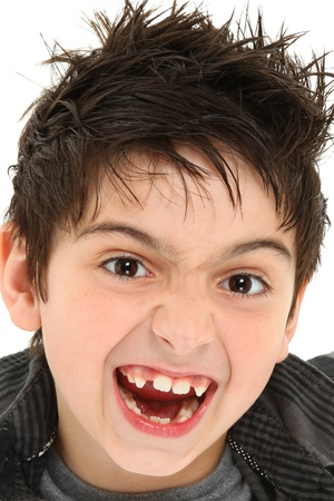 Hilarious 8 year old boy making crazy face up close. photo