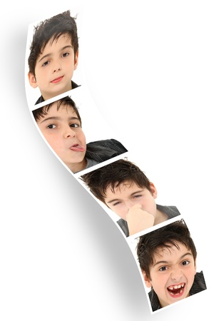 Multiple child faces and expressions on photo booth strip over white. Stock Photo