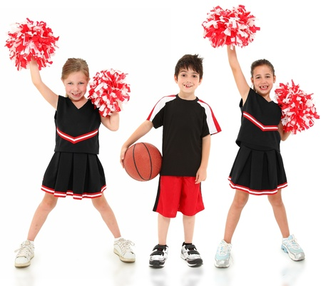 Group of boys and girls in cheerleader and basketball player uniforms over white. Stock Photo