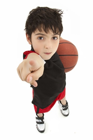 kid pointing: Aggressive boy child basketball player up close pointing in face over white. Stock Photo