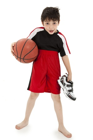 Boy child basketball playiing nerd with ball over white background. Zdjęcie Seryjne