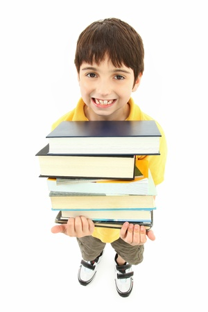 Back to school boy child with stack of text books and big smile. photo