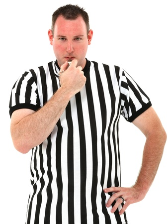 whistle: Attractive thirties referee blowing whistle over white background. Stock Photo