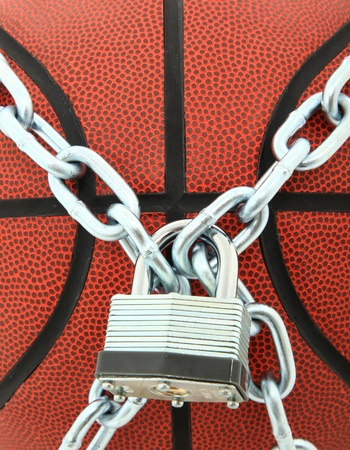 lock and chain: Closeup Of Basketball With Chain Link and Padlock
