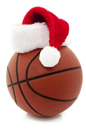 Basketbal Met Rode Kerstmuts On Top Stockfoto