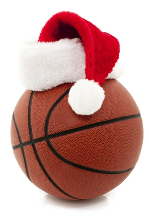 Basketball With Red Santa Hat On Top Stock Photo