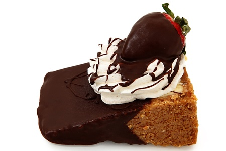 dipped: Single slice of cheesecake with strawberry and whipped topping dipped in chocolate ganache over white.