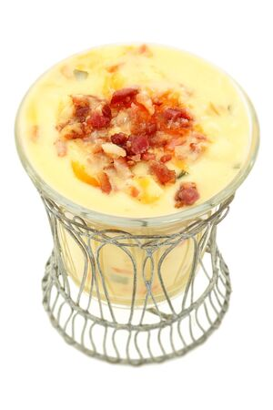 Decorative bowl of Irish Potato Soup with bacon and cheddar. Over white background. photo
