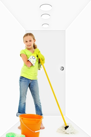 Child with mop bucket sponge in white hallway cleaning  photo