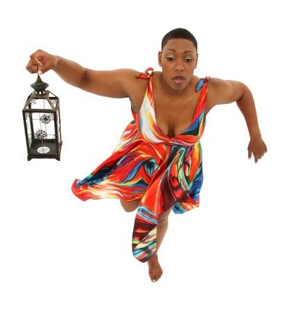flying woman: Beautiful Black Woman in Colorful Dress Floating over white background  Holding lantern