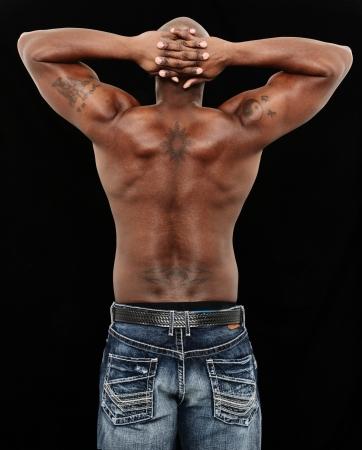 Back side of Fit Black Man in Jeans No Shirt