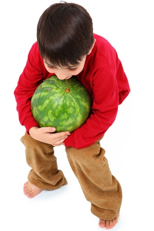 Happy Caucasian Boy Child Carrying Watermelon photo
