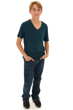 13: Attractive Teen Boy Caucasian Standing with Hands in Pockets. Serious expression. Stock Photo