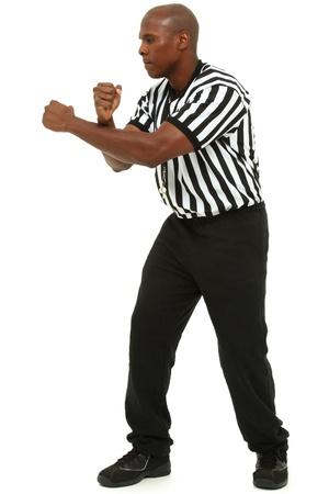ref: Attractive fit black man in referee uniform over white