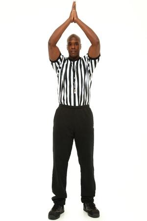 Attractive fit black man in referee uniform over white  photo
