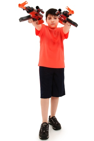Handsome French American Boy Aiming Two Plastic Toy Rifles photo