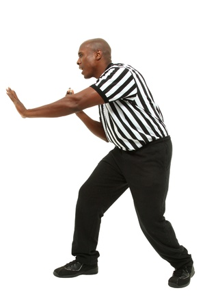 ref: Attractive fit black man in referee uniform facing side and yelling  Stock Photo
