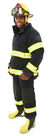 bombero de rojo: Atractivo hombre negro de mediana edad con un uniforme de bombero con trazado de recorte. Foto de archivo
