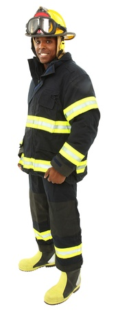 Attractive black middle aged man in fire fighters uniform with clipping path. Stock Photo