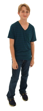 13: Handsome shy teen boy standing over white with clipping path. Stock Photo