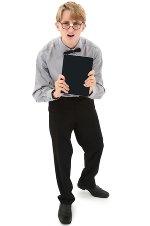 geeky: Funny nerd teenage boy with electronic e-book reader. Clipping path over white. Stock Photo